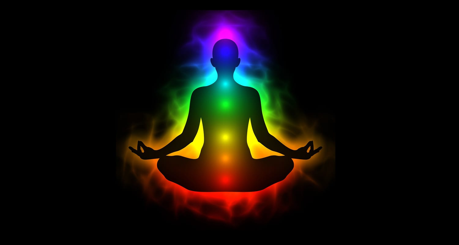 Silhouette of body with energy and chakra points in colors